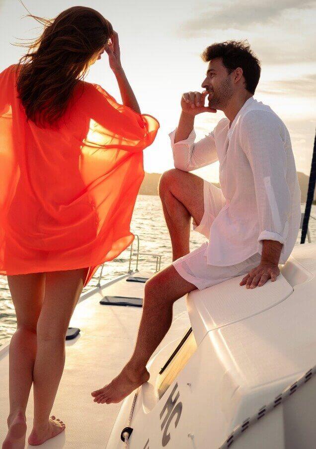 Couple Sailing during Sunset