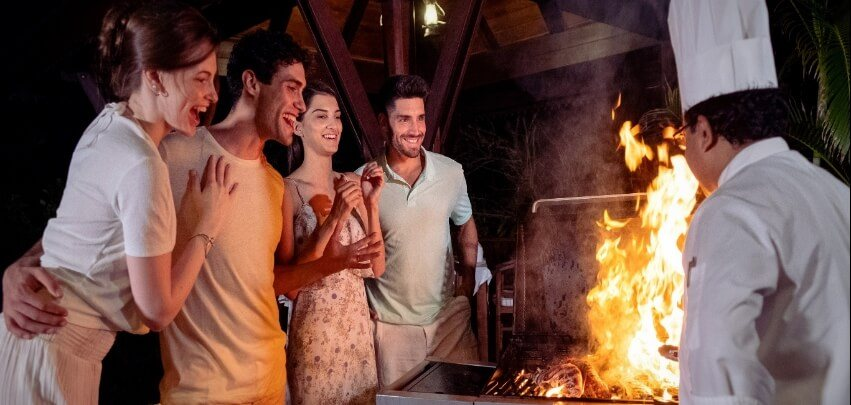 Couples Admiring Food on Grill