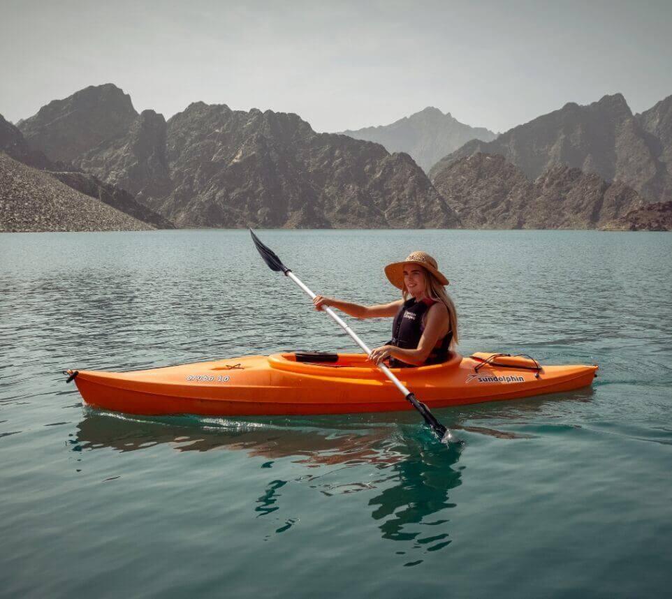 Woman Kayaking on Lake