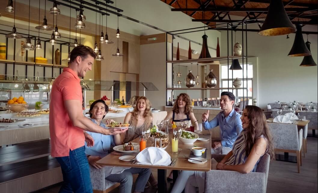 Group Eating at Restaurant