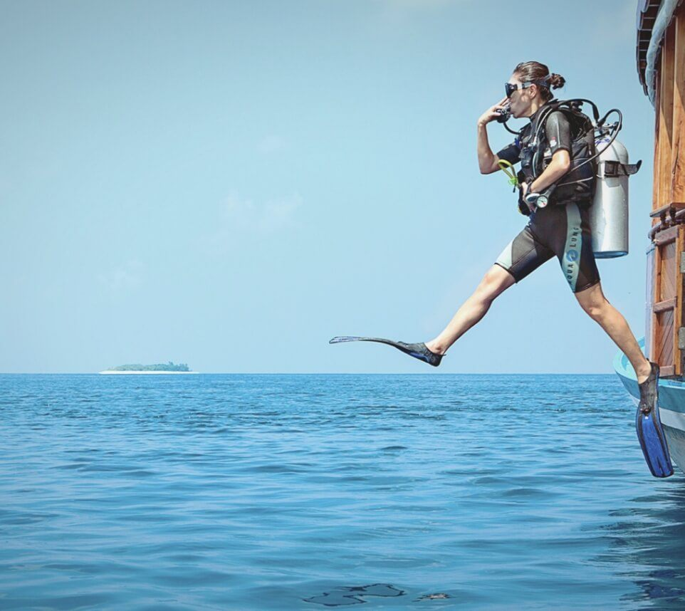 Women Jumping off Boat with Snorkeling Gear