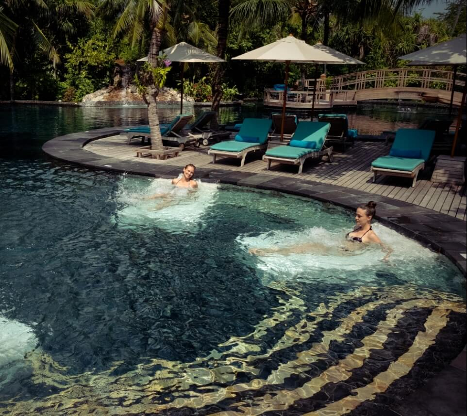 Women Relaxing In Pool