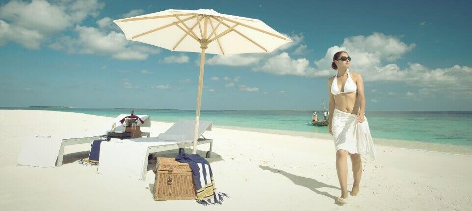Women Walking Beside Beach Umbrella