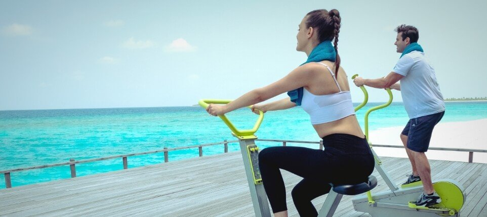 Couple on Outdoor Fitness Equipment
