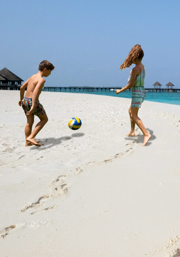 Kids Playing Soccer on the Beach