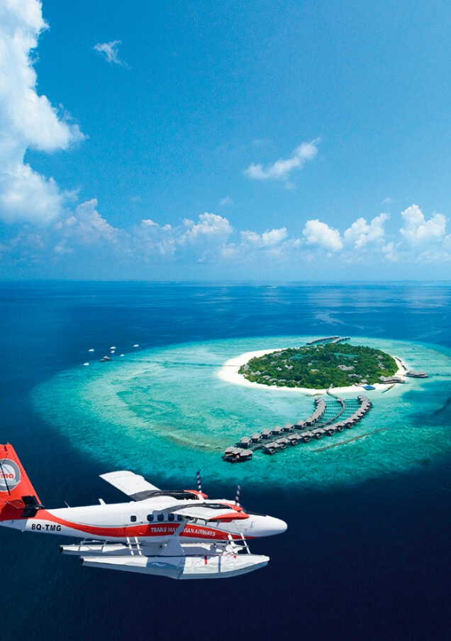 Seaplane Flying Into Maldives Resort