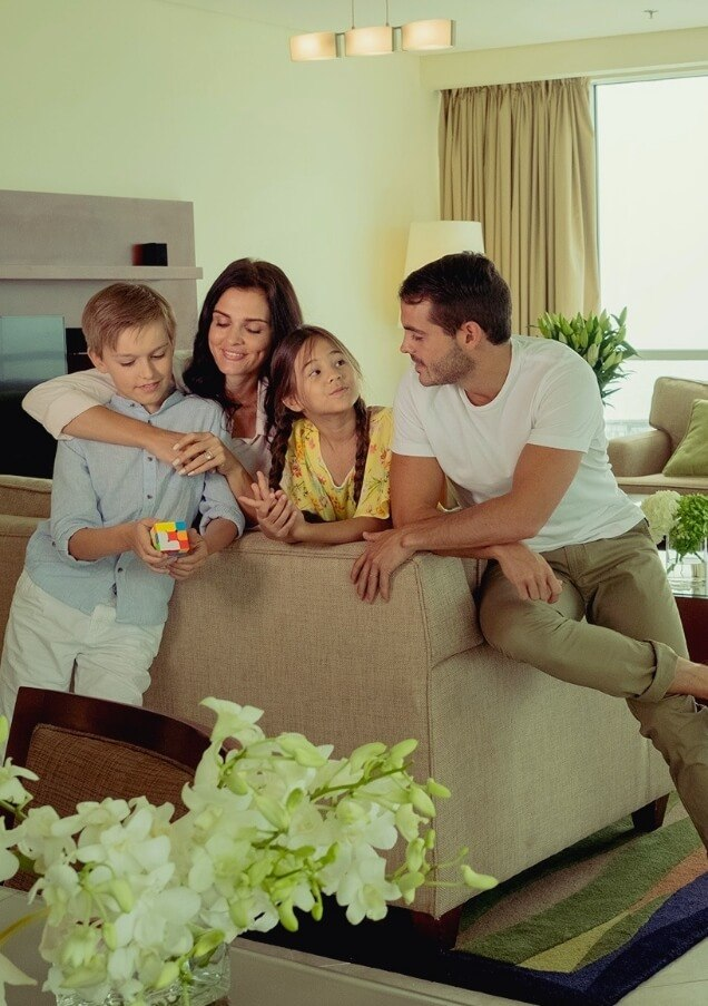 Family Leaning on Sofa