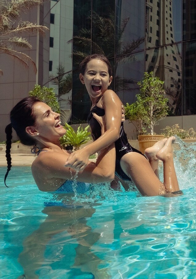Family Playing in Hotel Pool