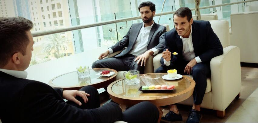 Business Men Sitting in Lounge