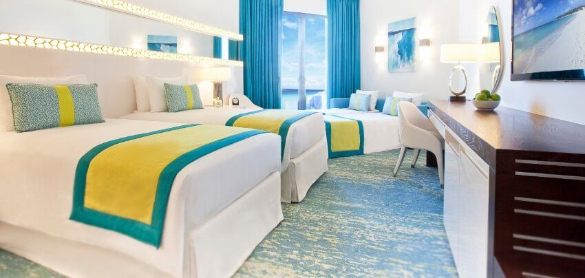Sea View Hotel Room With Multiple Beds