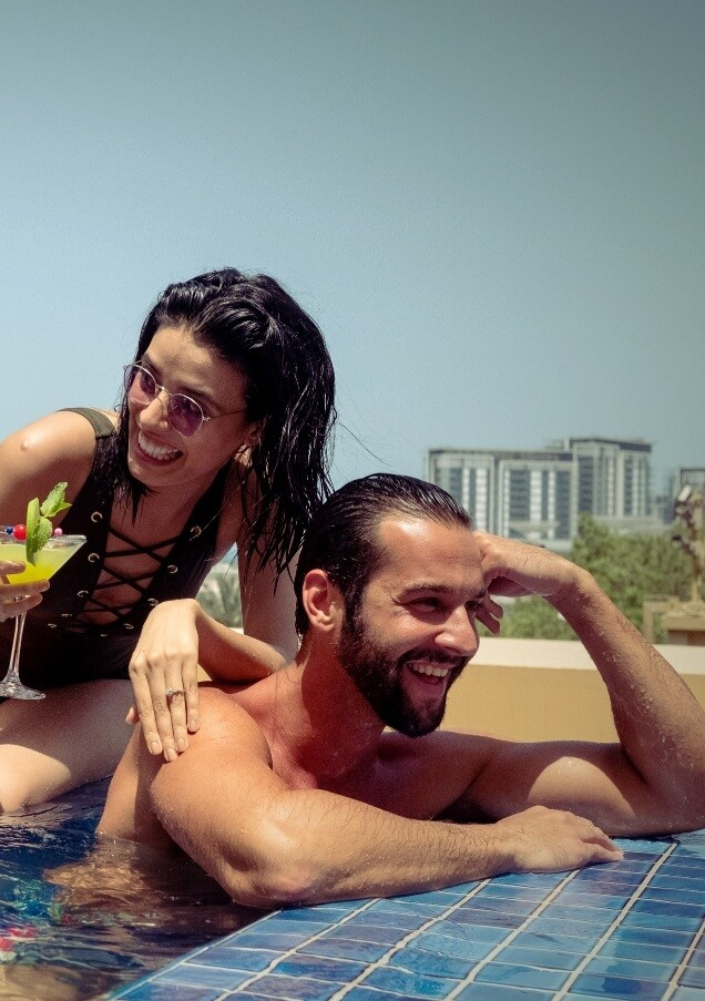 Couple Having Cocktails In Pool