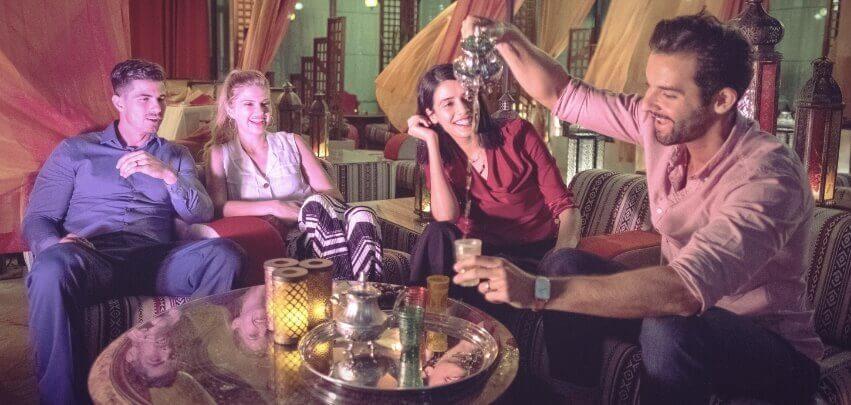 Couples Having Tea At Restaurant