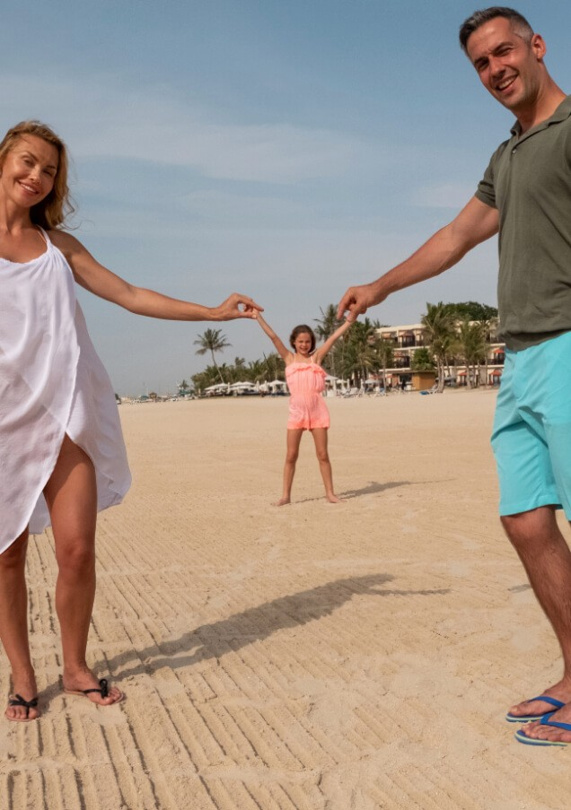 Parents Posing with Daughter on Beach