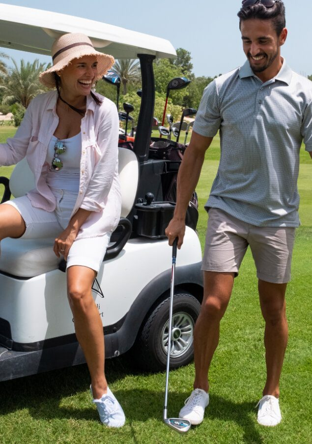 Couple with Golf Cart