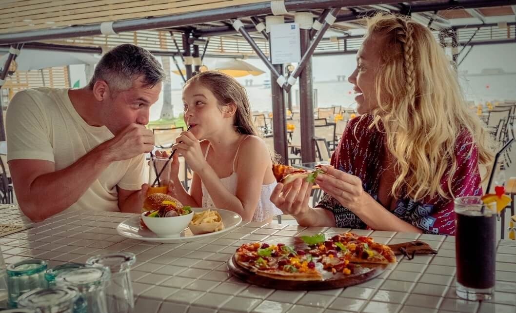 Family Eating Burgers And Pizza