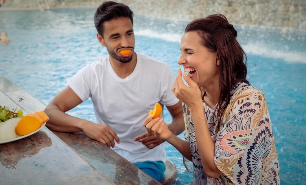 Couple At Poolside Bar