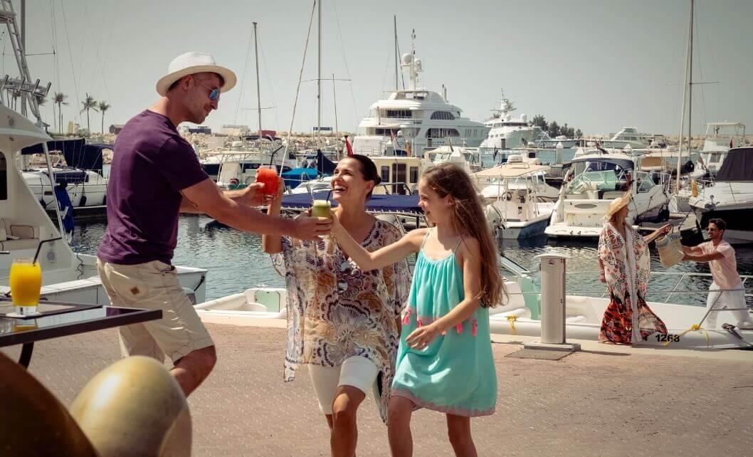 Family With Drinks At Marina
