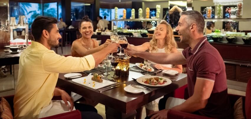 Couples Toasting At Dinner