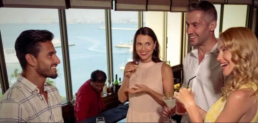 Couples Talking At Bar