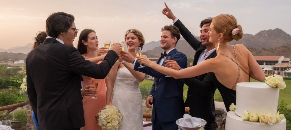 Friends Toasting at Mountain Wedding