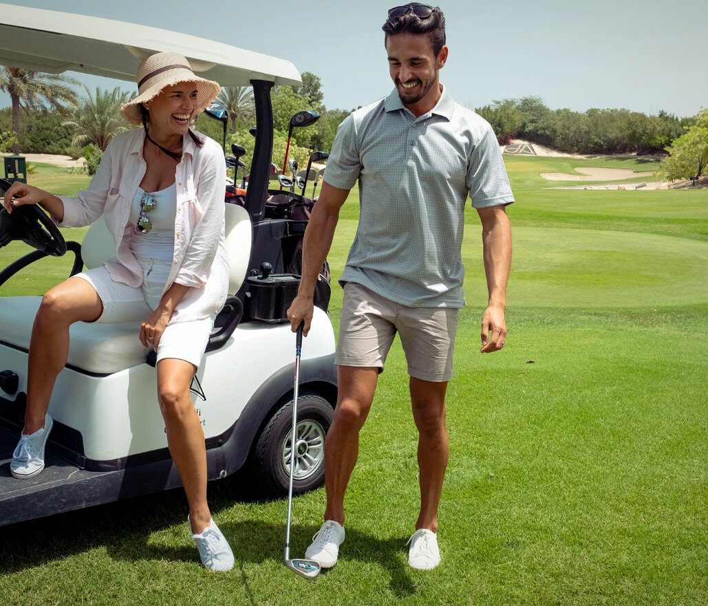 Couple On Golf Cart