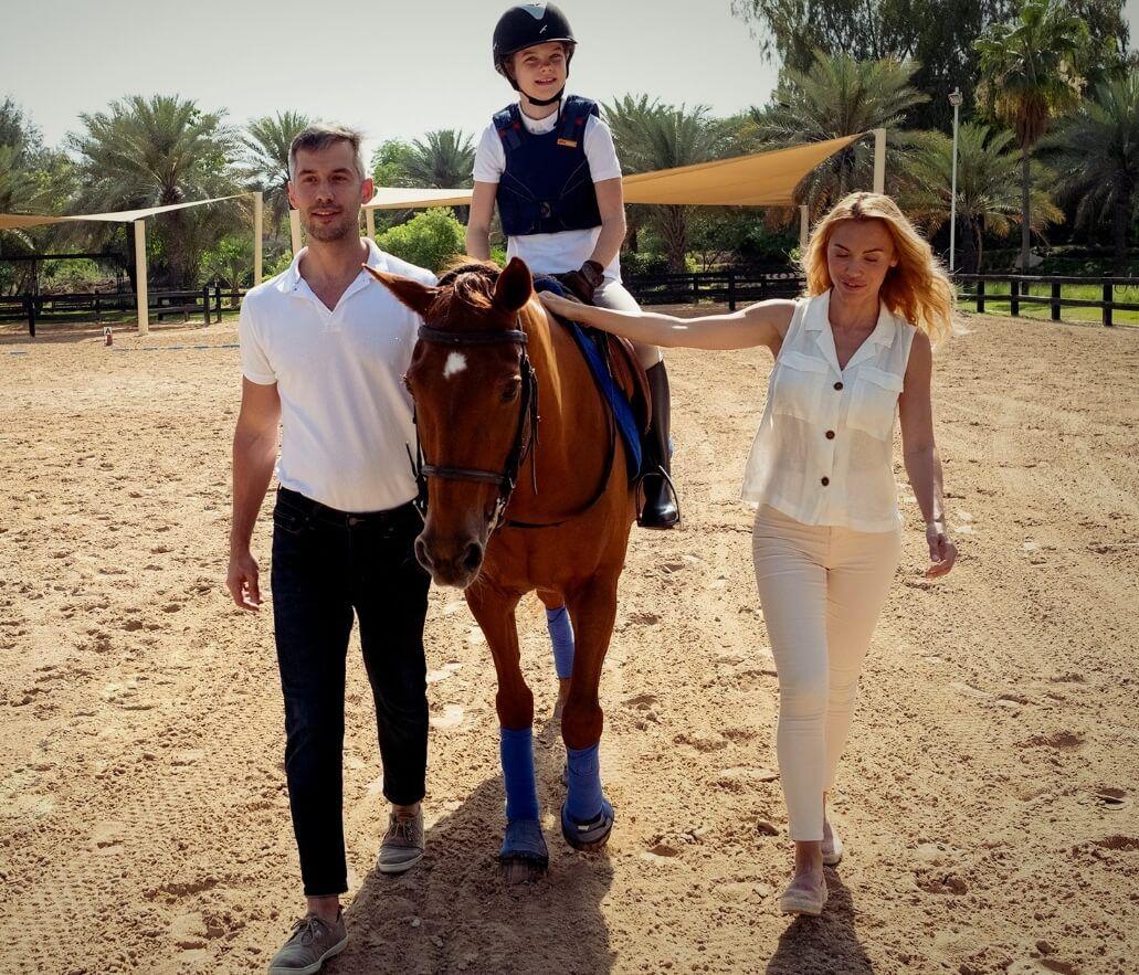 Family Walking Alongside Horse