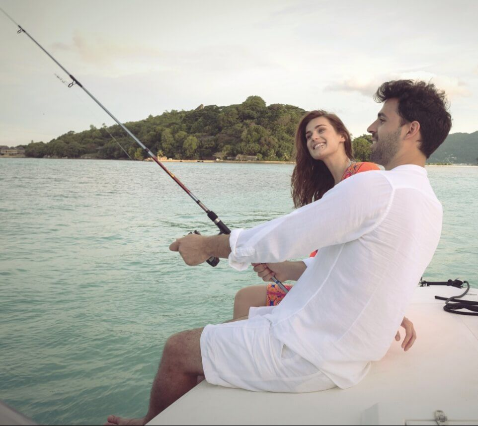 Couple Fishing on Boat