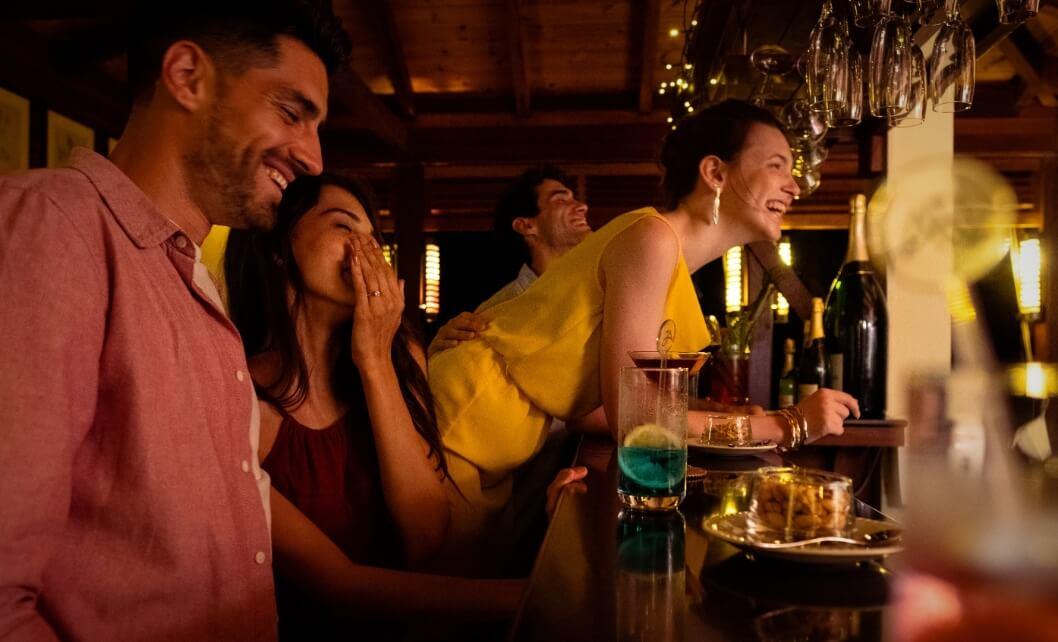 Friends Laughing at Bar