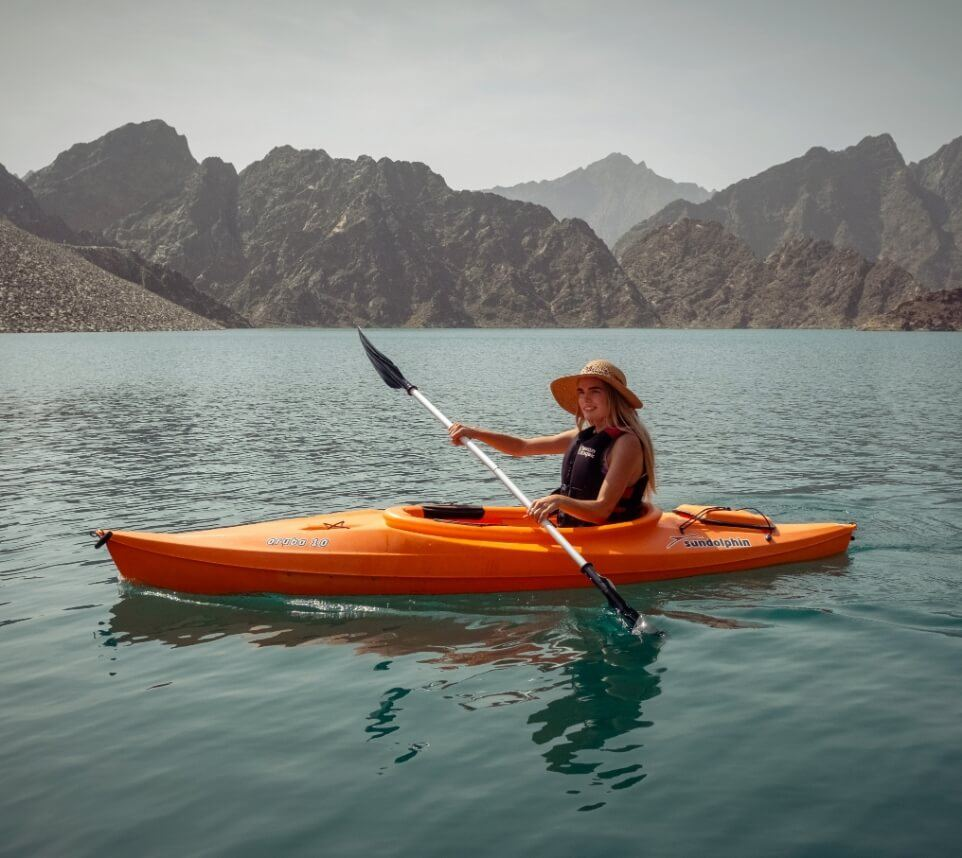 Woman Kayaking on Lake