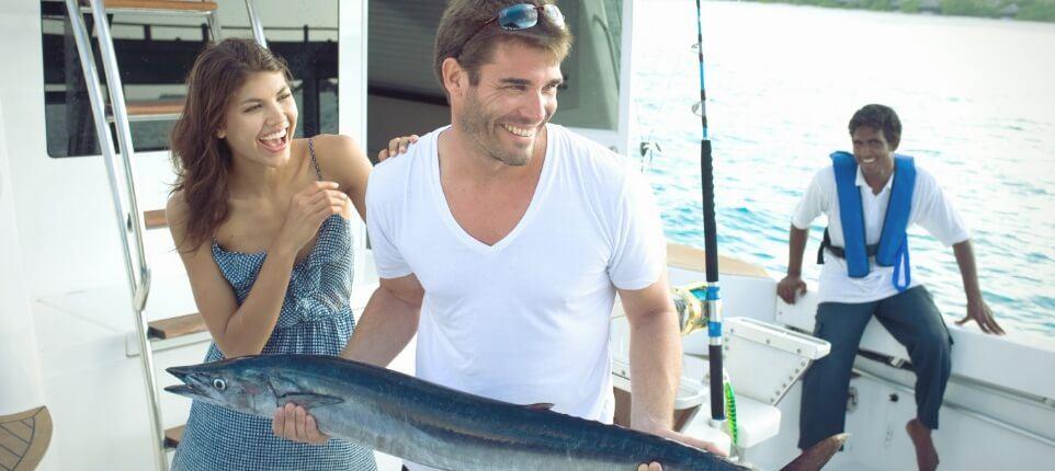 Couple Fishing on Boat
