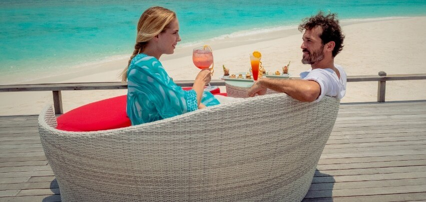 Couple on Lounger Enjoying Drinks