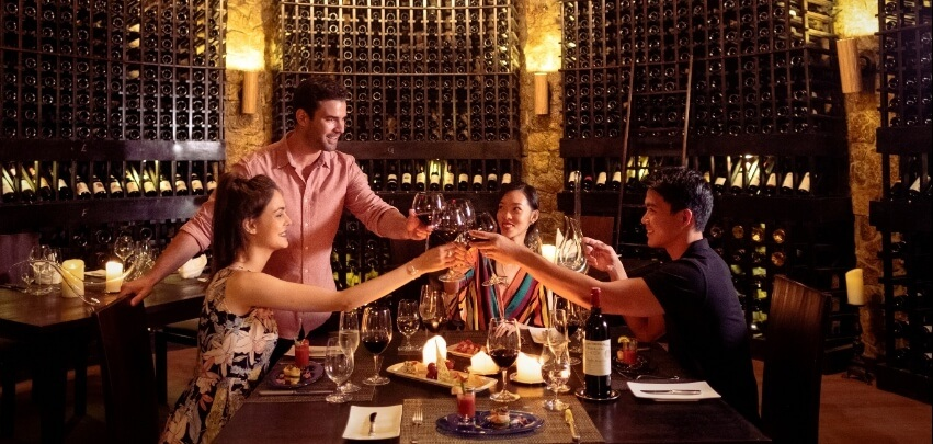 Couples Toasting in Wine Cellar