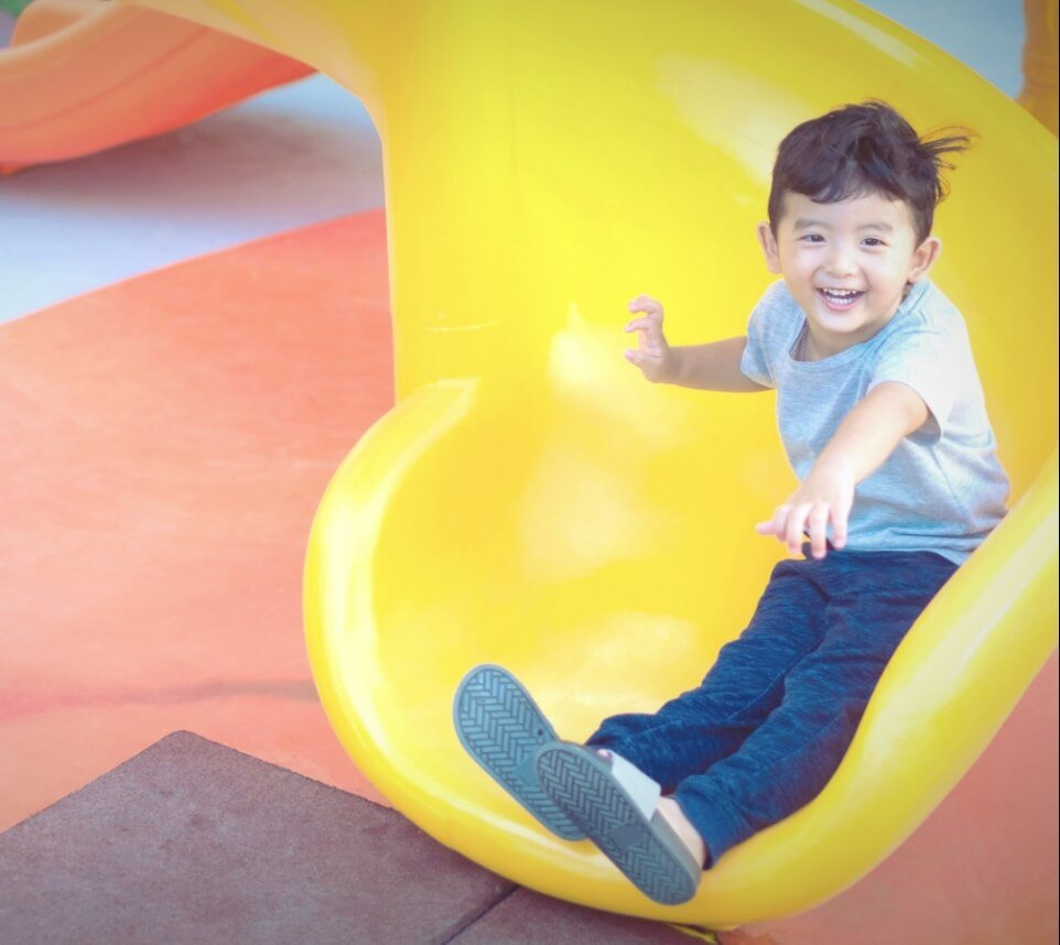 Kid On Yellow Slide