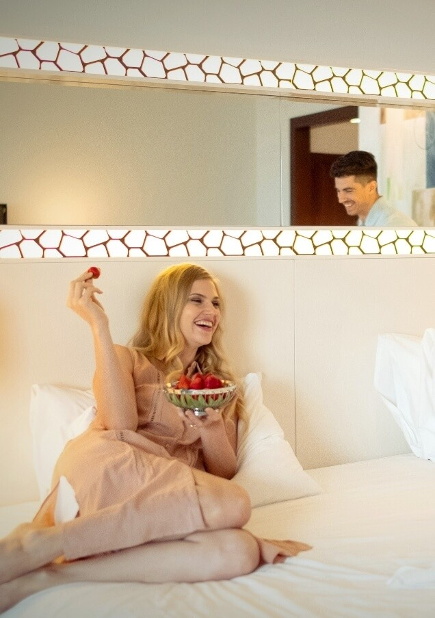Woman Eating Strawberries In Bed