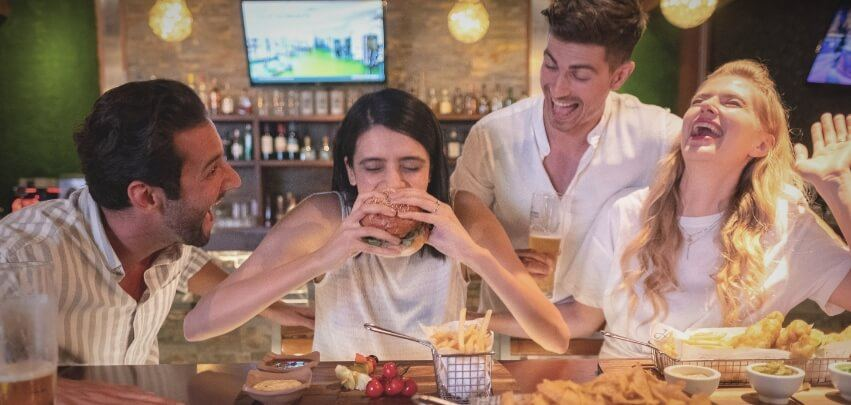 Couples Having Burgers And Drinks