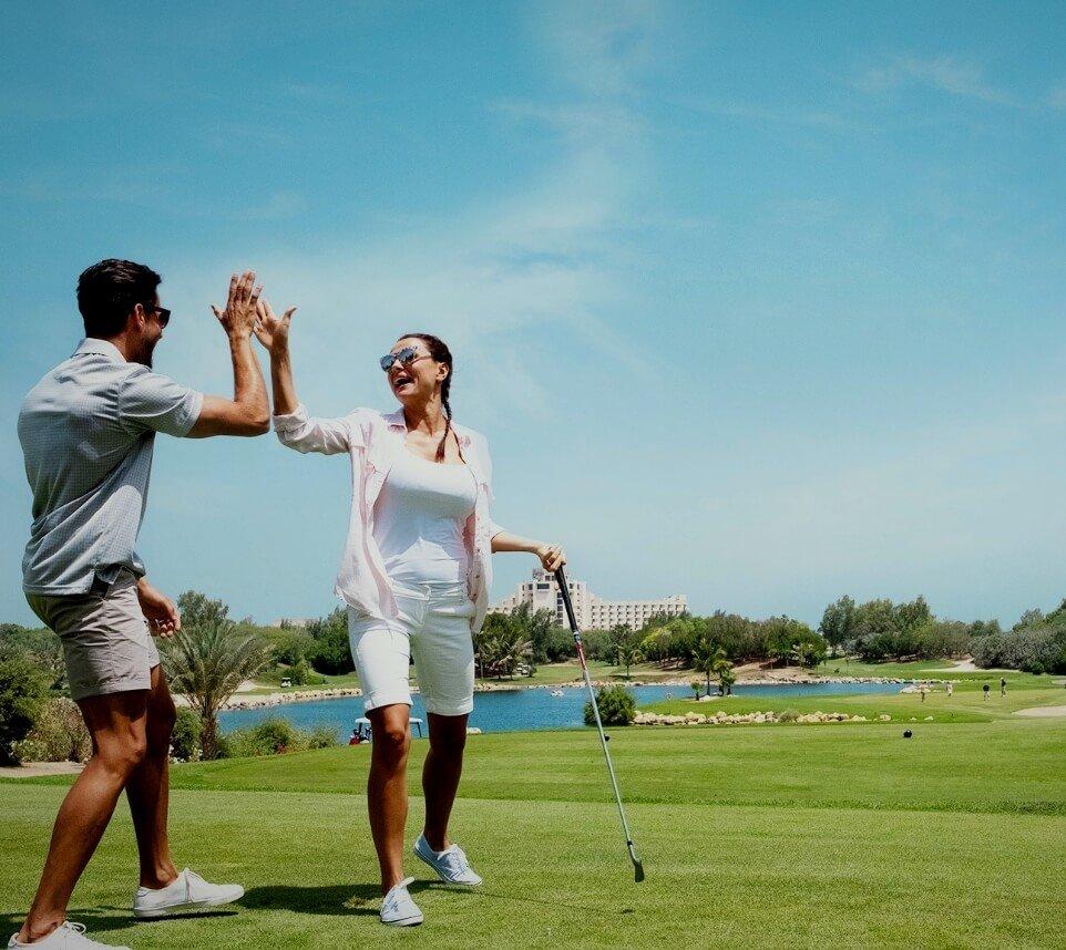 Couple Celebrating on Golf Course