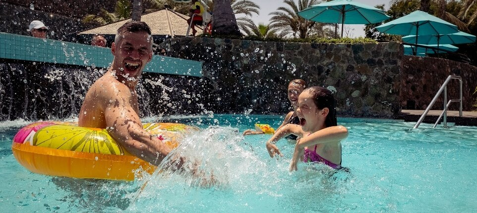 Family Splashing In Pool