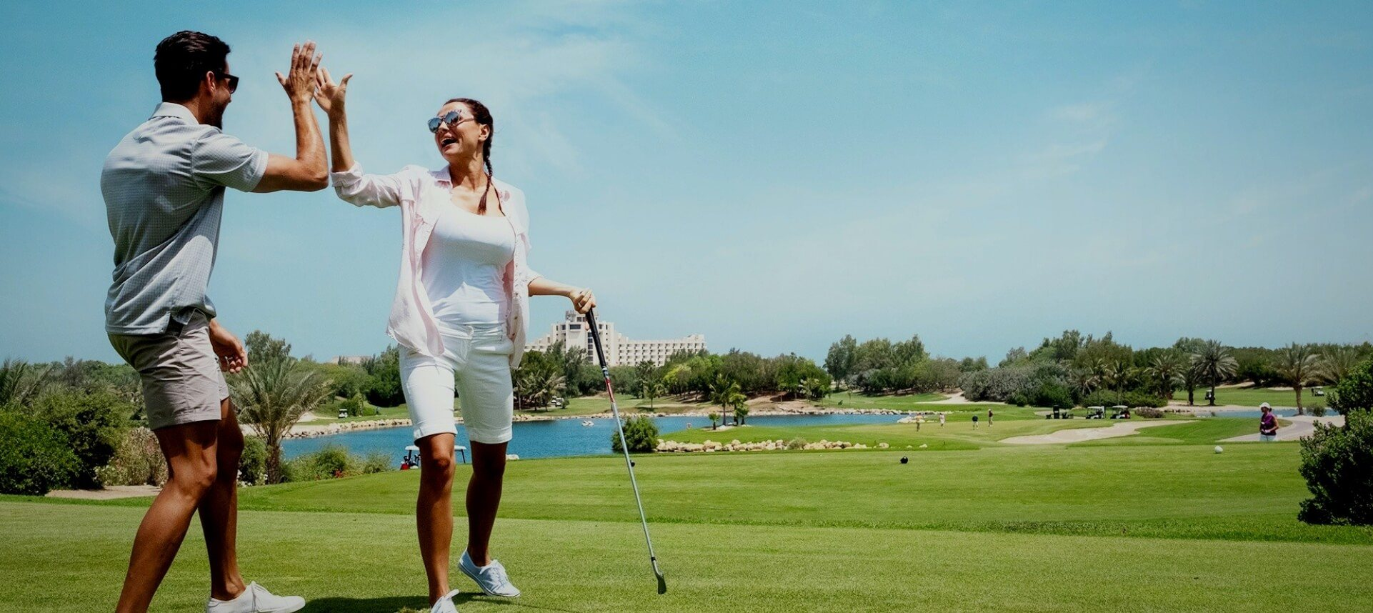 Couple Celebrating on Golf Course