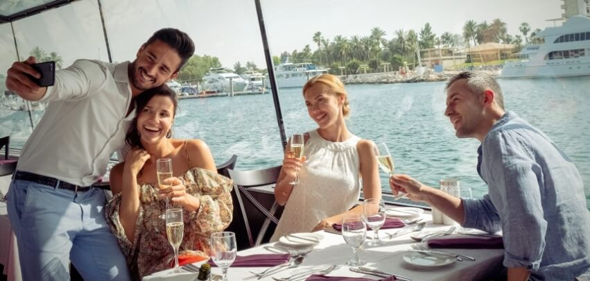Couples At Dinner On Boat