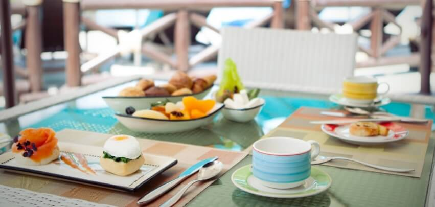 Outdoor Table With Breakfast Dishes