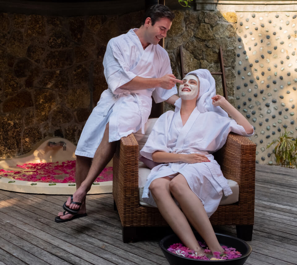 Couple in Bathrobes Relaxing on Patio